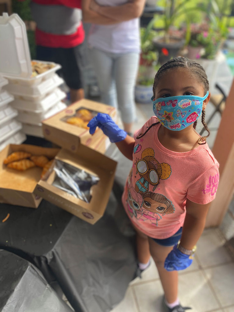 Little girl next to pastries